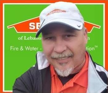 head shot of man in front of SERVPRO background
