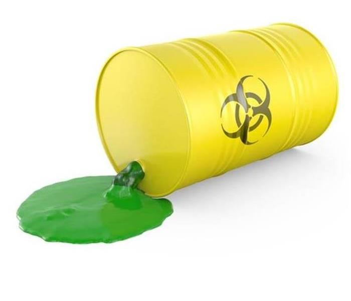 picture of yellow hazardous waste drum tipped over and spilling