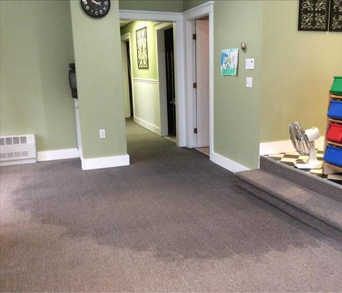 Hair salon office with water damage on carpet