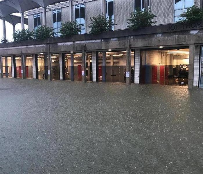 pic of commercial building with flooding rain