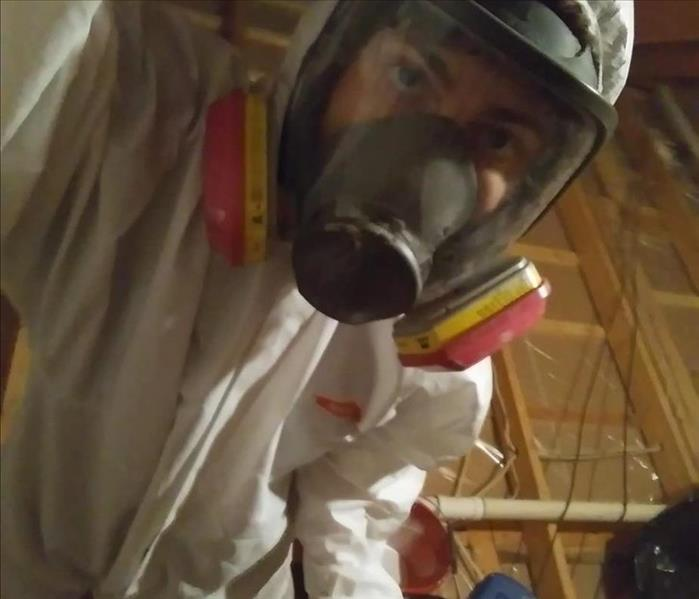 closeup of mans face in hazmat suit